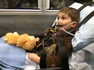The EMS staff gave him an adorable teddy bear.