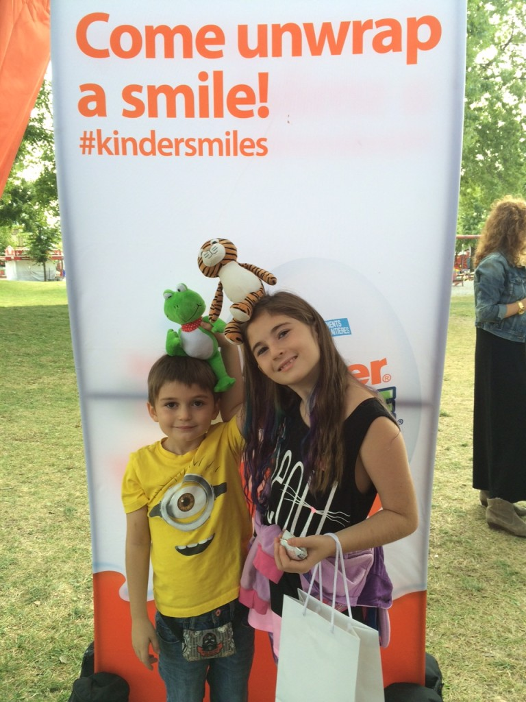 Unwrap a smile at at the Kinder booth at the CNE